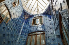Gaudi used dark blue tiles at the top of the stairwell and light blue towards the bottom to give the illusion of more light down below