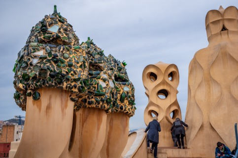 On the roof-top, Gaudi used broken tiles to decorate the hats of the chimneys