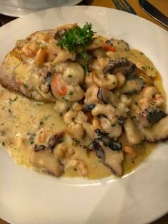 Pomfret with seafood marinara sauce